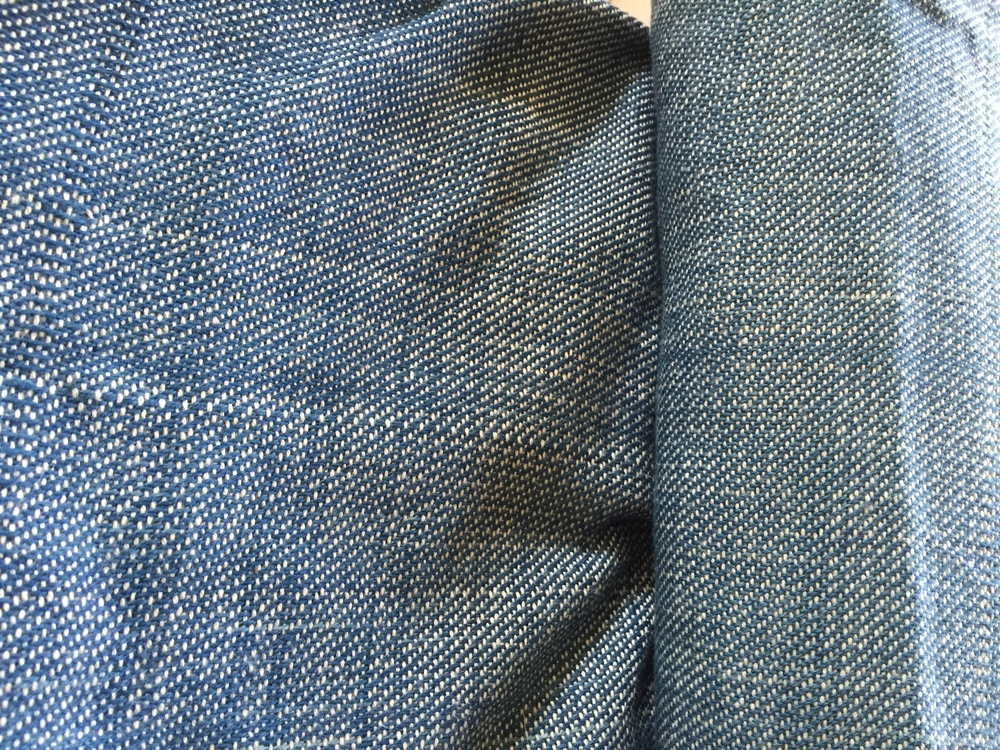 Close up on the weave structure of handwoven denim.