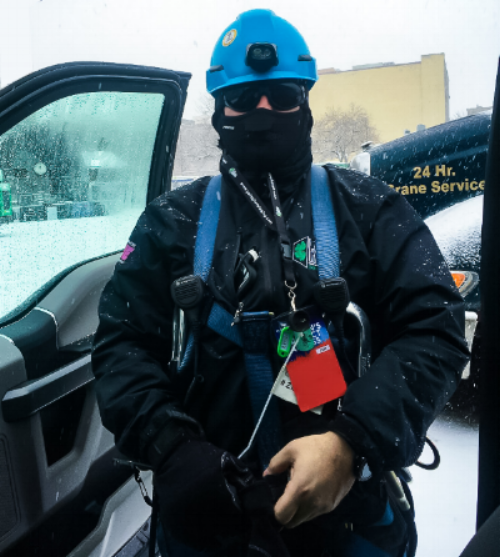 Joe Golden of Gallagher Staging & Productions bundles up in proper gear for the Minneapolis Weather Conditions at his crew's Super Bowl build.