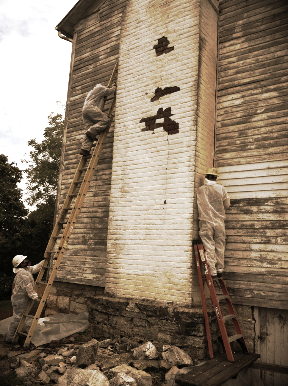 This image is from a project in Elizabethton where three of our certified asbestos workers  removed caulking from the chimney of a house that will be renovated and saved for historic purposes.