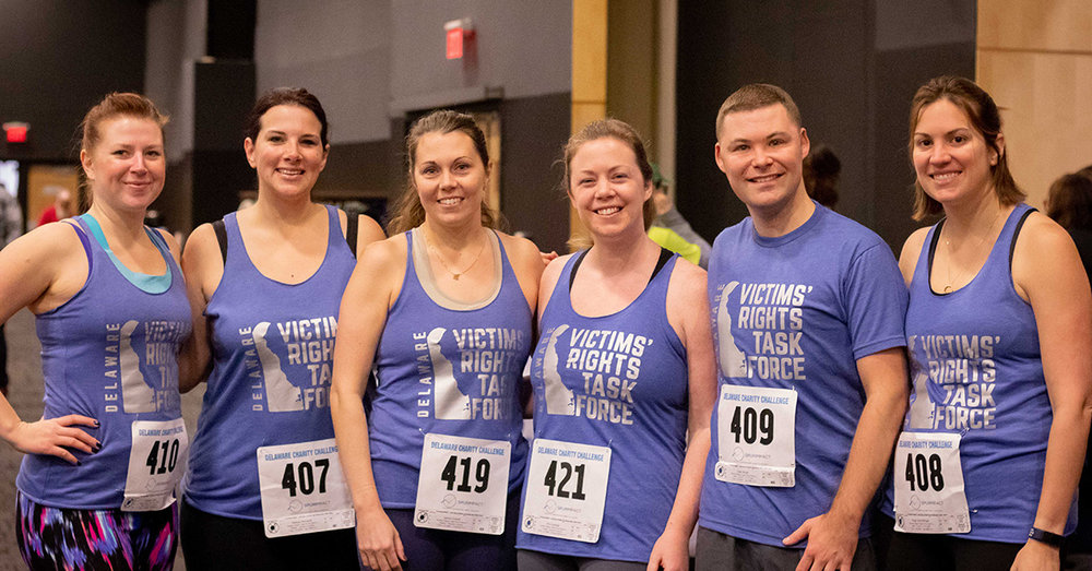 Members of the Delaware Victims' Rights Task Force competed in the 2019 Delaware Charity Challenge winter indoor triathlon and raised money for Delaware Center for Justice. Team members also won the Run, Row, Bike Co-Ed W, W, M division in the indoor triathlon. Photo credit  Four Youth Productions .