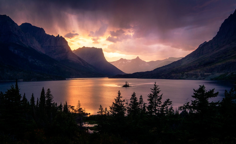 A thunderstorm in Glacier National Park illuminates the sky