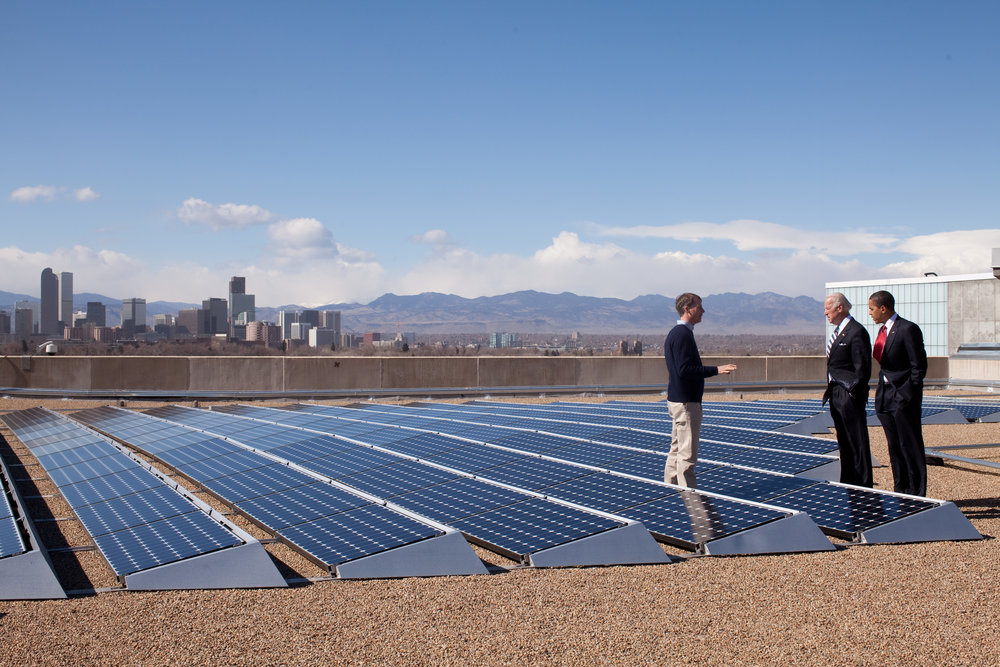 A 2009 shot features then-President Barack Obama and Vice President Joe Biden surveying a solar garden in Denver, CO, with Blake Jones, CEO of Namaste Solar Electric, Inc. The solar industry has grown exponentially since this photo was taken.