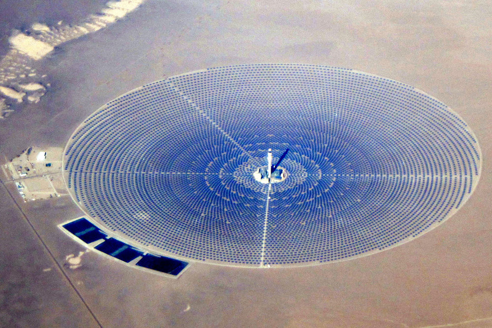 The Crescent Dunes Solar Energy Project, located in the desert near Las Vegas, NV, is the first utility-scale concentrated solar project. The spiral of mirrors heats the central power tower (which stands 640 feet tall and is filled with molten salt) which in turn creates steam to use for electricity generation.