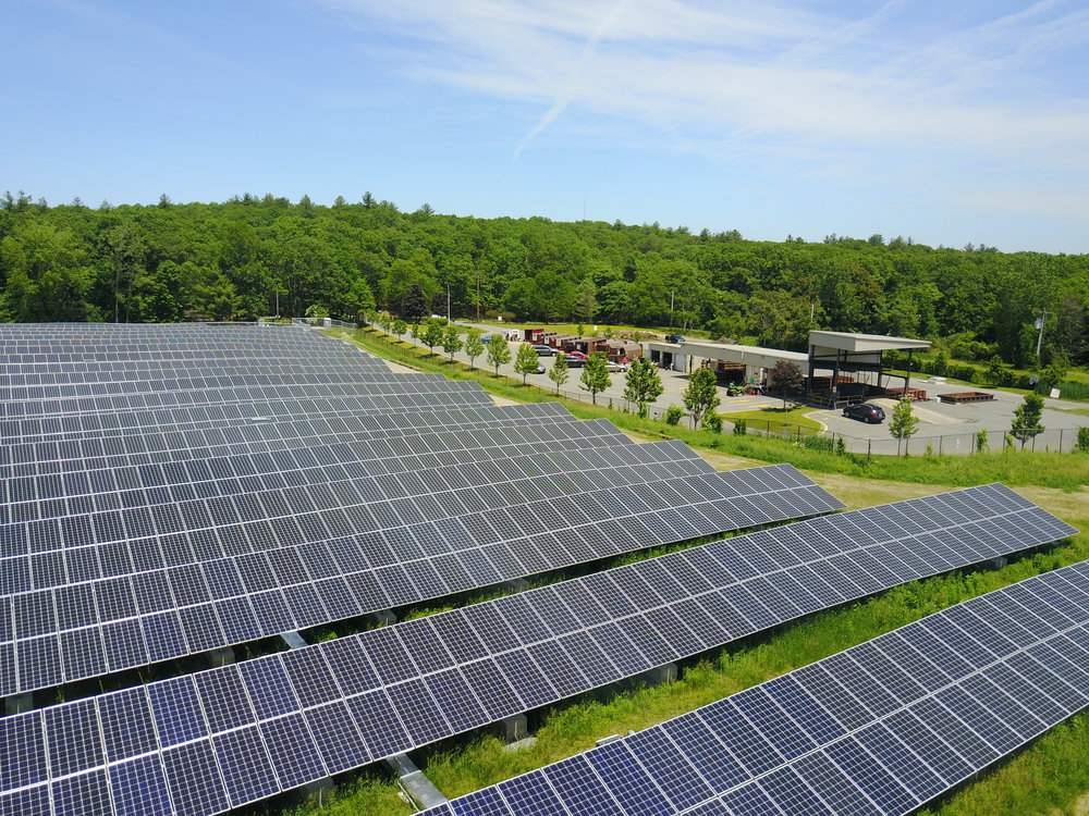 A community solar garden in Dover, MA, developed by BlueWave, was built on the top of a capped landfill.
