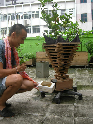 Here's Michael showing me the wonderfully strange planter that someone made them using discarded materials.