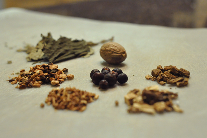 Clockwise: nutmeg, burdock, dandelion root, sasparilla, birch bark, ojasanta and juniper berries.