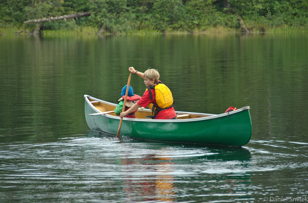 Josh taking Grace out for a spin in the canoe during a momentary pause in the rain.