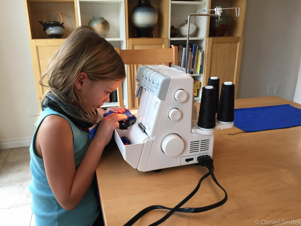 Cousin Eva sewing together her bandana on a serger.