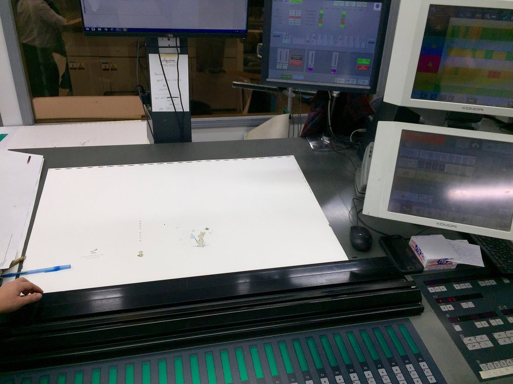 The cover papers are ready to print at Signature Printing. Here we make sure the color is exactly what we want to see. Once they are printed they are sent down the street to Taylor Box Co.