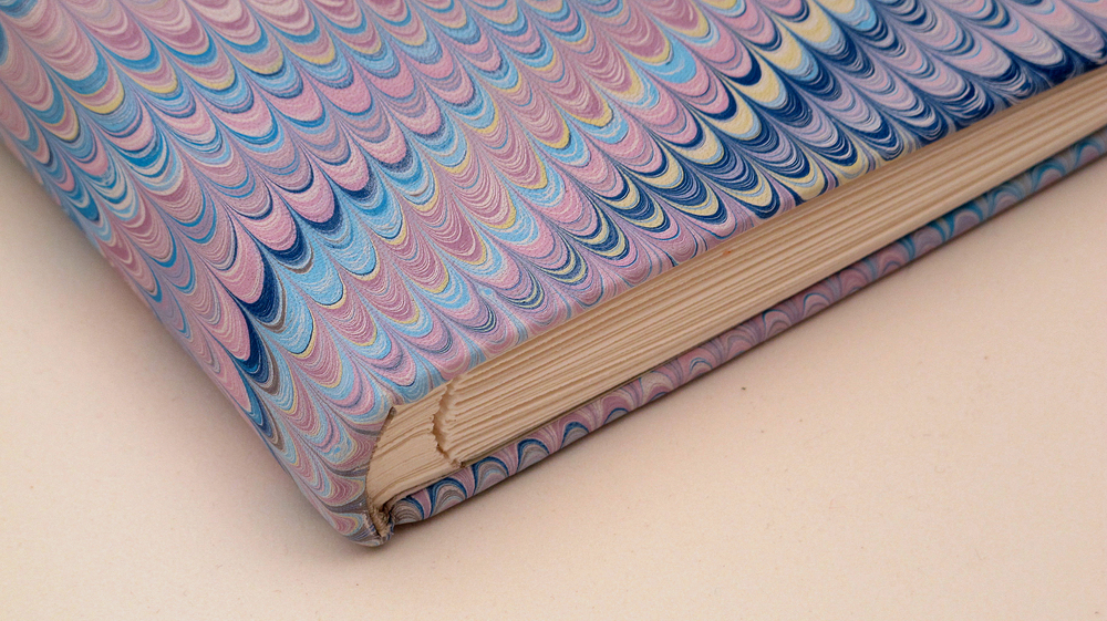 Small portfolio book with hand-marbled leather cover