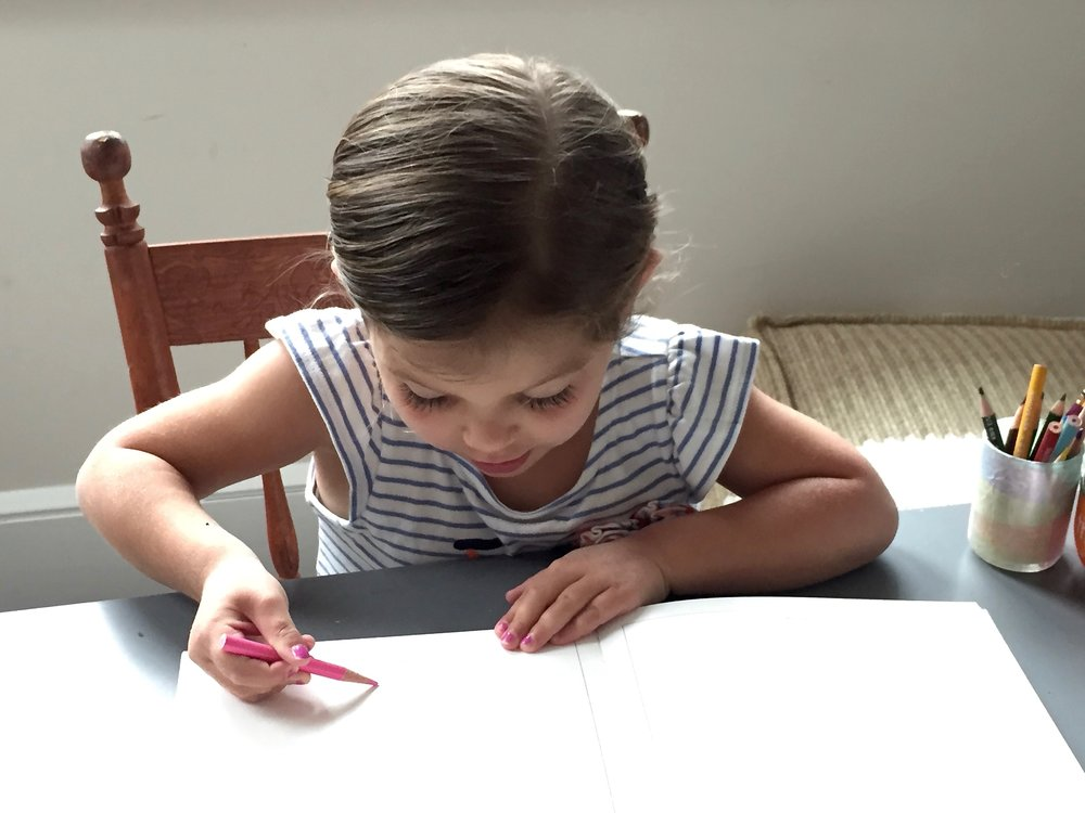 Lila experimenting with a colored pencil.
