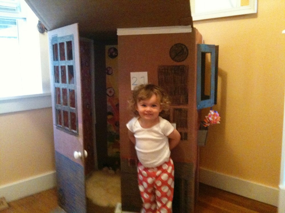 Skyler and her cardboard box house, age 1.9