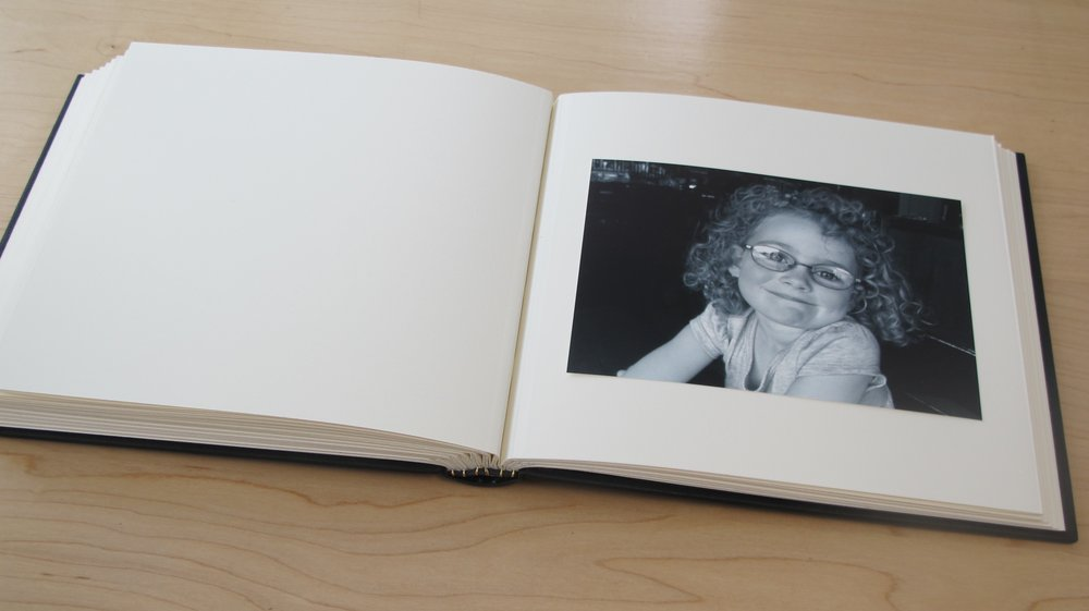 I love this style of binding - Montage sur onglet. The pages open so easily and lay flat which makes it perfect for a photo album.