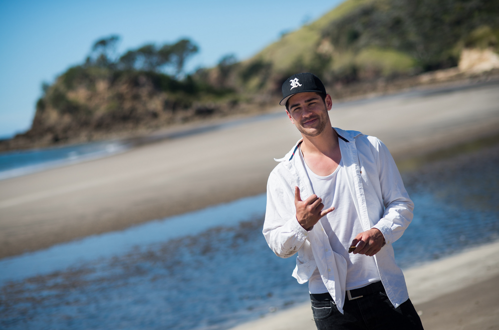 RISKY smiles for the camera on location, Medlands Beach, Great Barrier Island. Photo: Glenn McLelland, Aerial Vision.