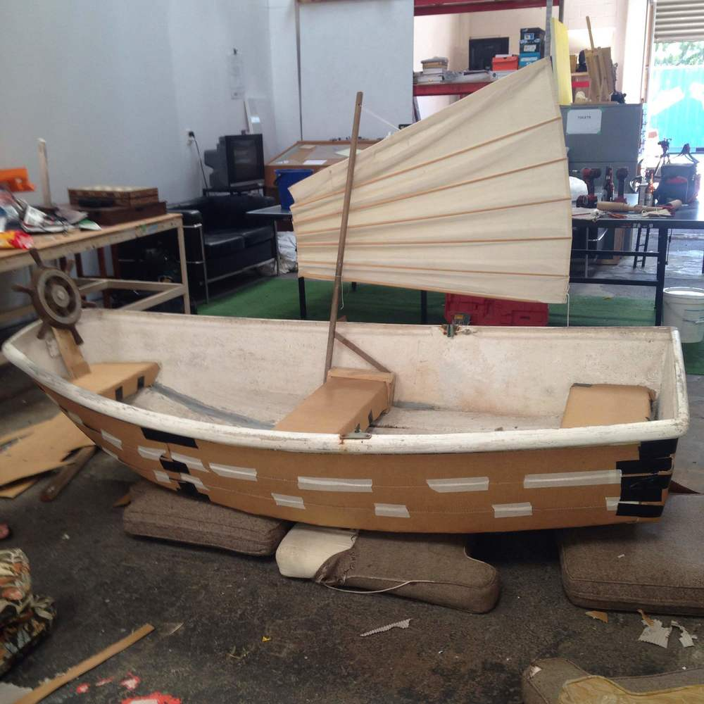 Above:   The sailboat fashioned as a Chinese junk, before being painted.  Many thanks to Peter of Lyall Bay for letting us transform his rowboat!
