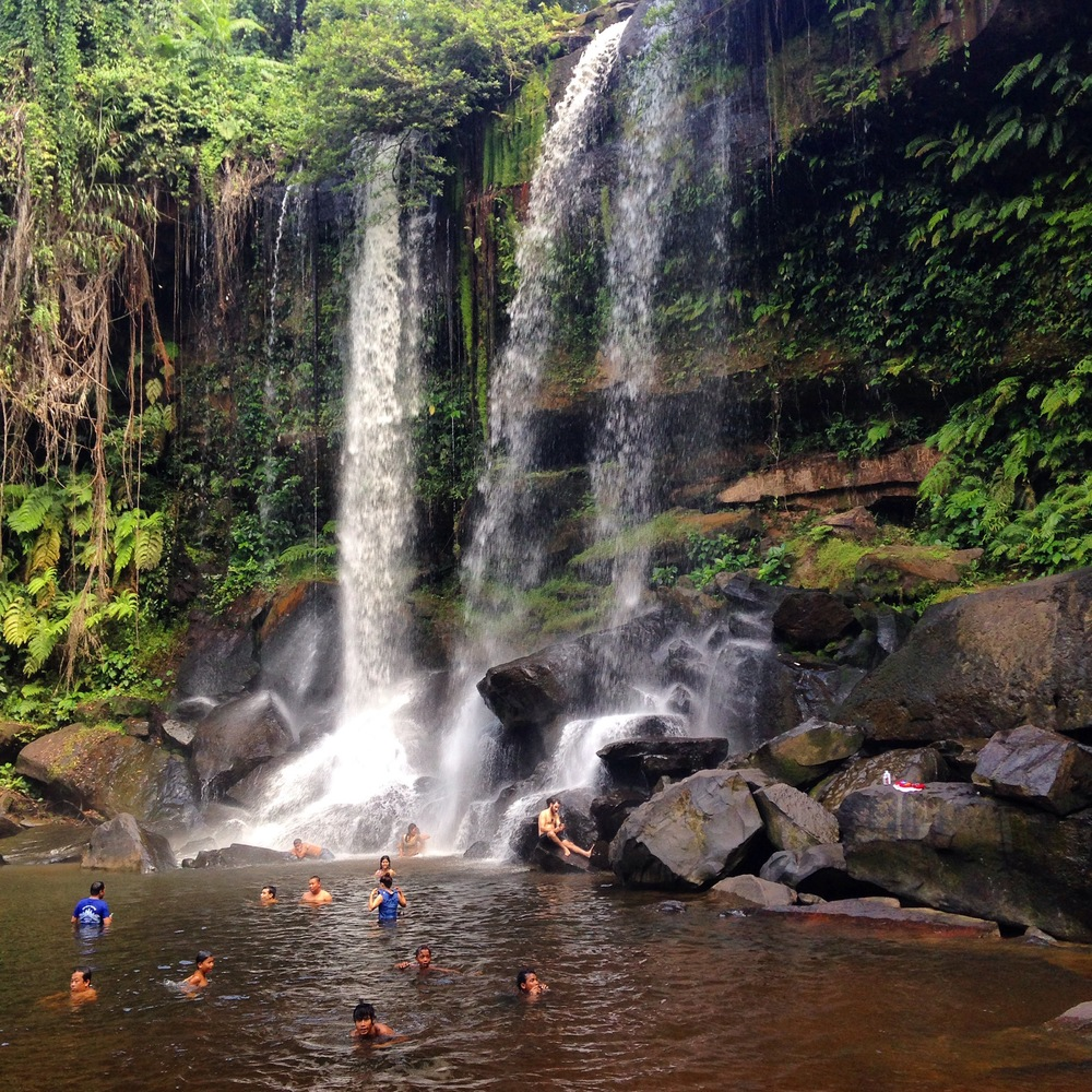 The waterfall at Kbal Spean and local swimmers