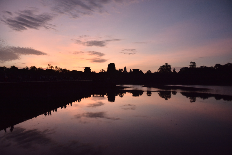Angkor Wat just before the dawn. If you look at the reflection on the moat you can see the crowds making their way for the sun ceremony.