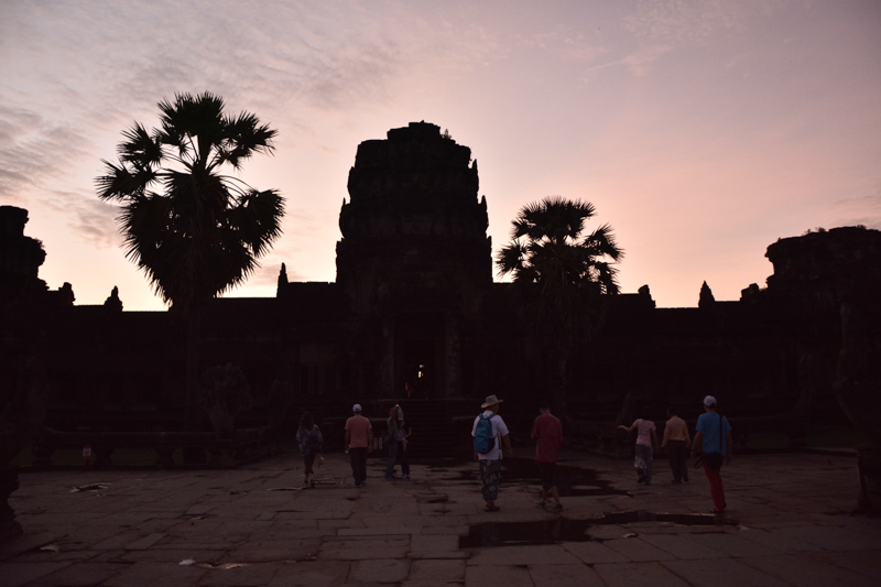 Tourists finding their own space to witness the dawn over this ancient temple, Angkor Wat, Siem Reap
