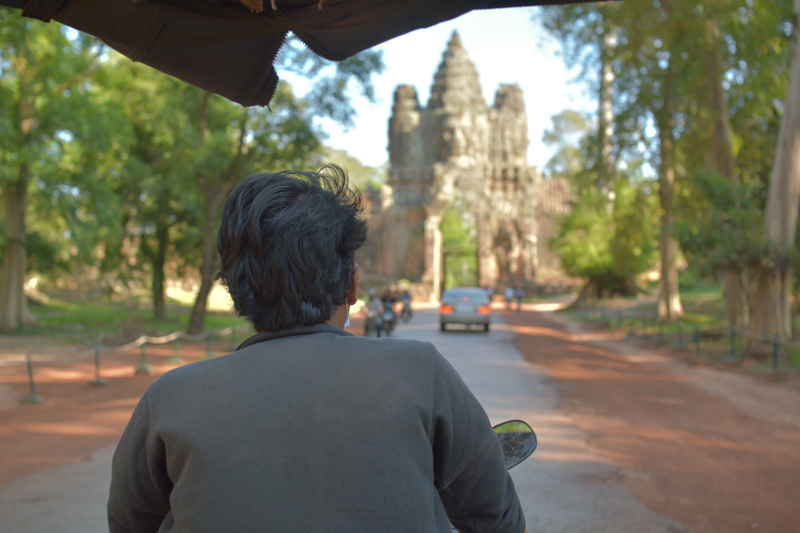 Sky in action - on the tuk tuk heading towards the gateway to Bayon Temple.