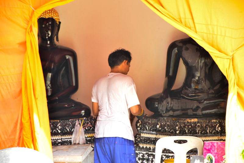 Keeping the Buddha statues in prime condition