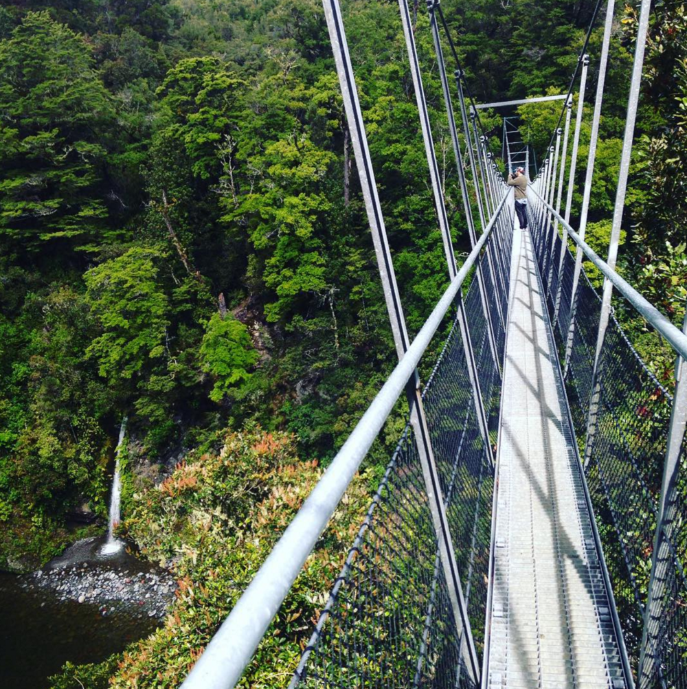 Mark crossing a swingbridge over the Waiohine Gorge