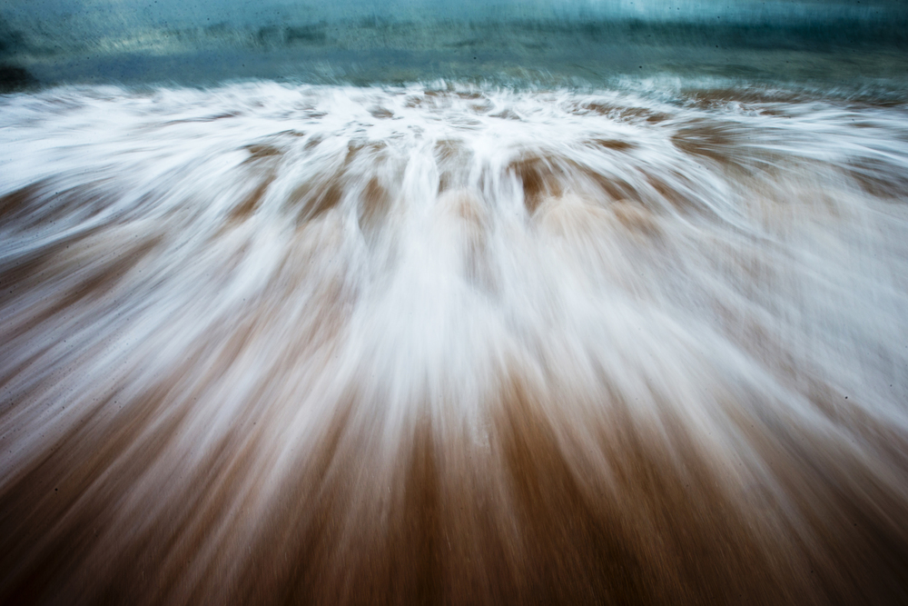Overcast skies allow the chance to slow the shutter speeds down and let things go blurry. Examining the movement over form. This the last moment of surrender for a wave that started its journey a long time ago.