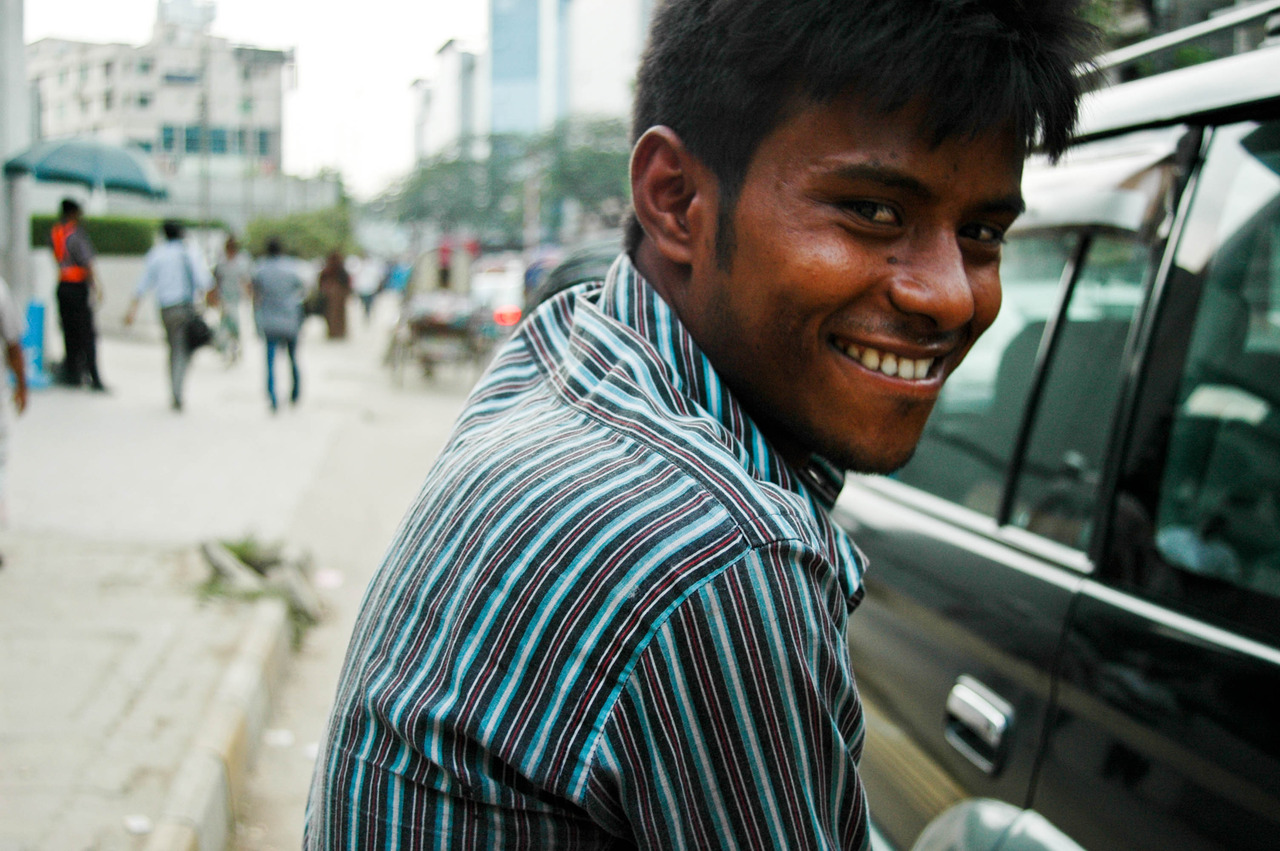 our rickshaw driver giving the camera a flirtatious look   ©amanda.lee