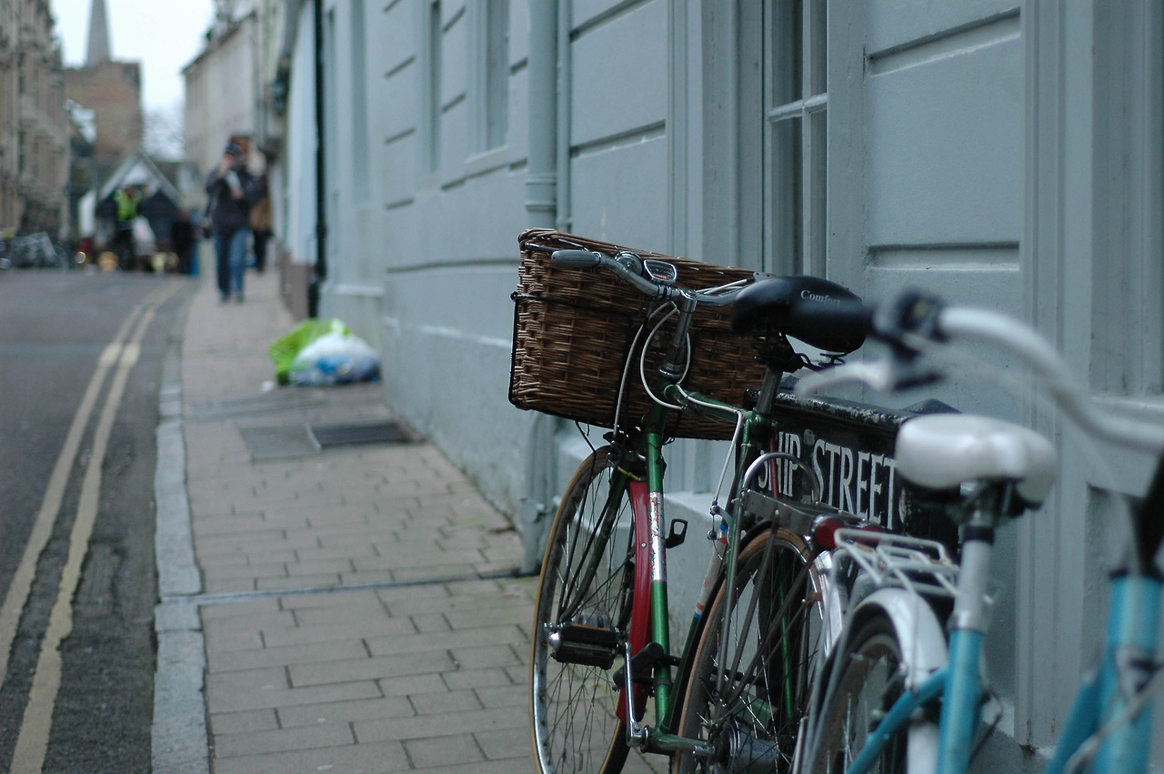 Oxford, England. One of my favorite places in the world. Every single Oxford student owns a bicycle with a basket in the front, fortunately Oxford students don't have the urge to steal bikes as often as American college students, and therefore they don't have to worry about locking them up.