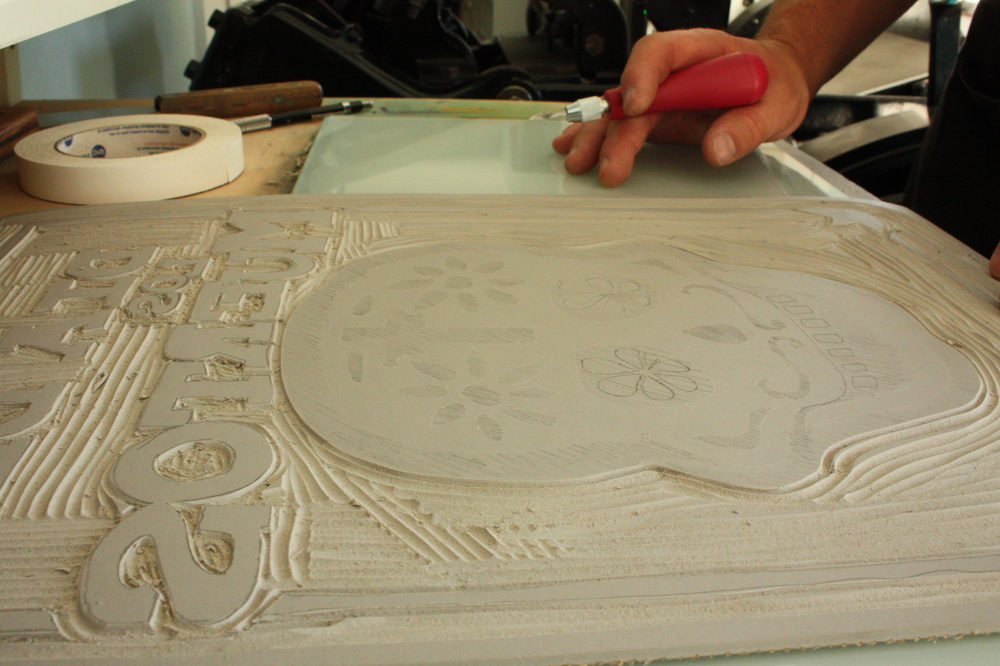 Linoleum cut Wilcz finishes carving as we chat.