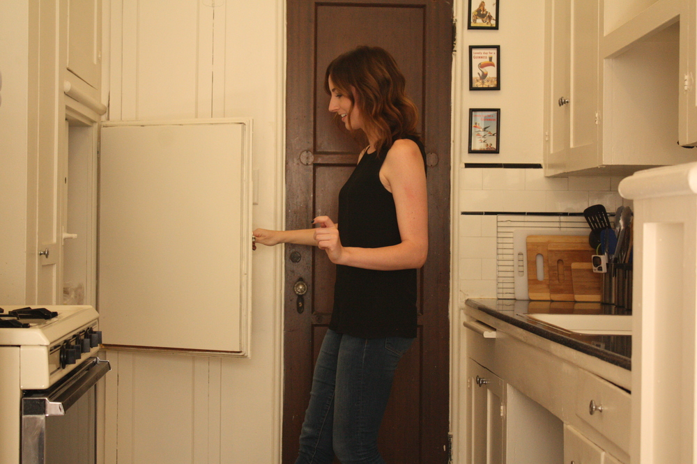 A favorite feature of her apartment: an original refrigerator she now uses as a cabinet.