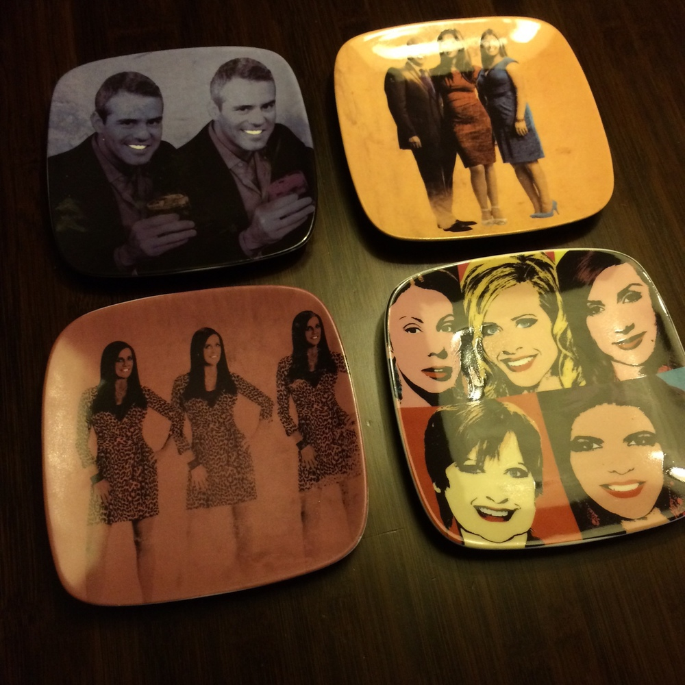 Some plates he got as a Xmas give from Bravo one year...because who hasn't always wanted to eat a muffin off of Andy Cohen or the Millionaire Matchmaker's face.
