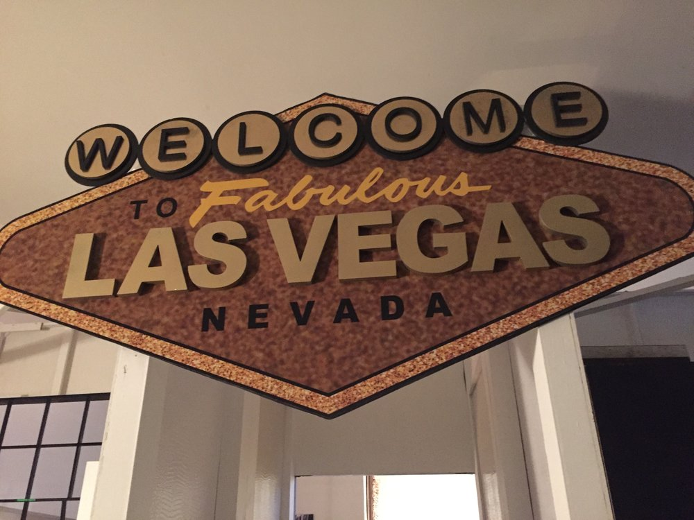 The Vegas sign that leads the way to the home part of John's home / studio.