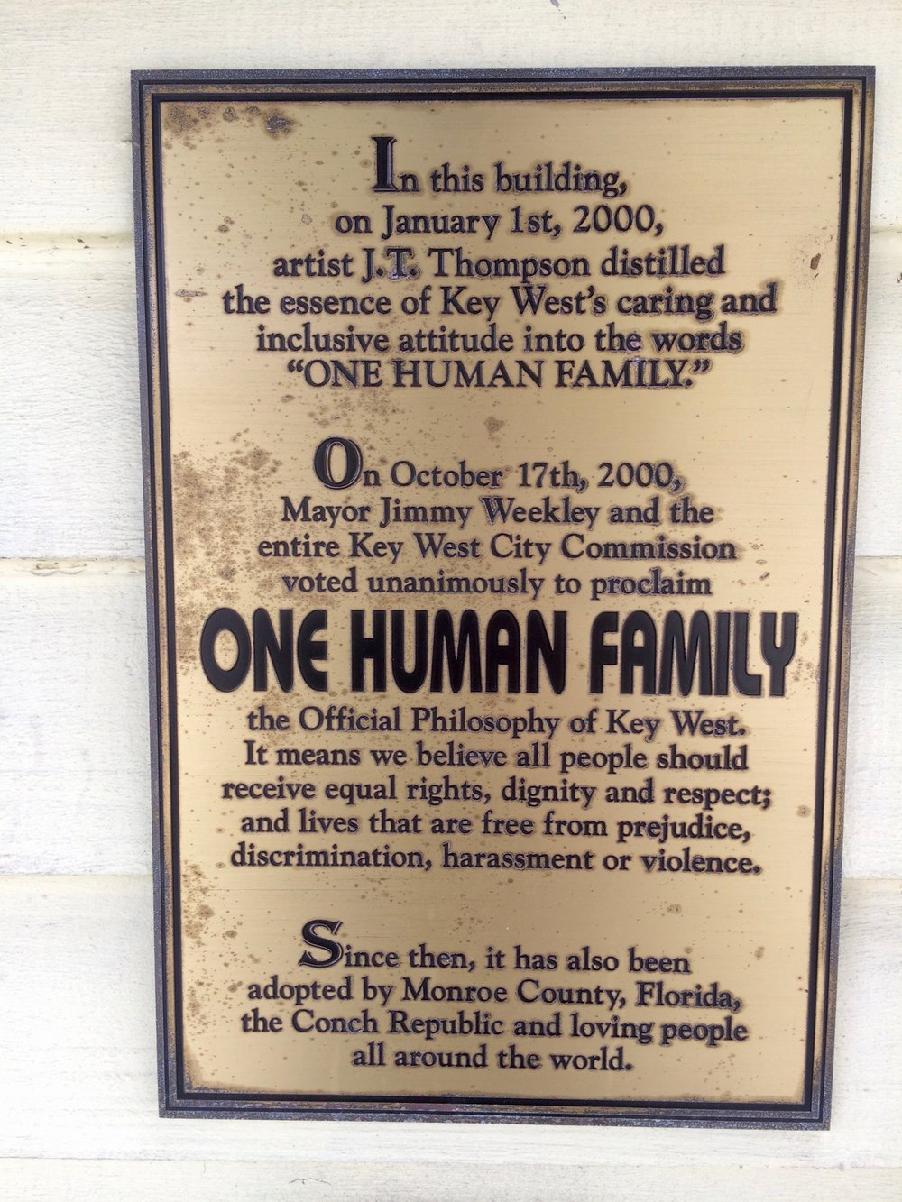A plaque honoring the One Human Family movement
