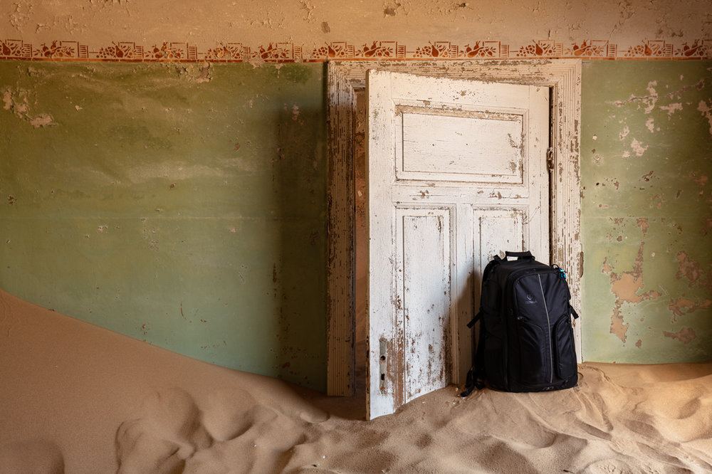 My Tenba Shootout 32L rucksack in sand filled building number 10.