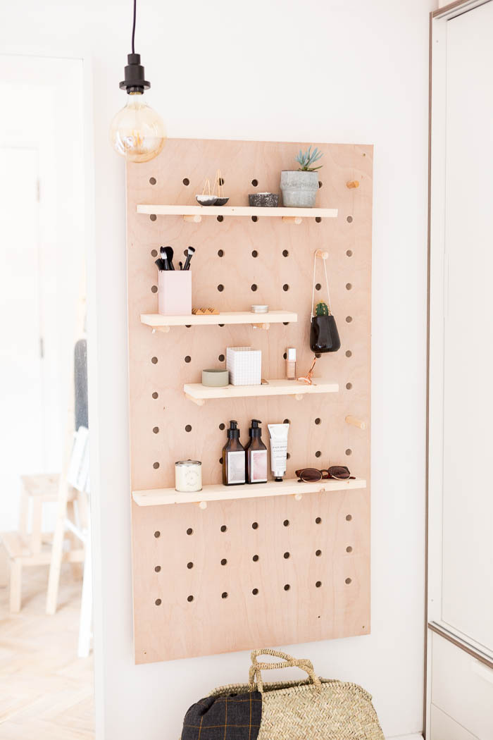 DIY Standing Vanity with Pegboard & Hidden Mirror Storage from Fall For Diy