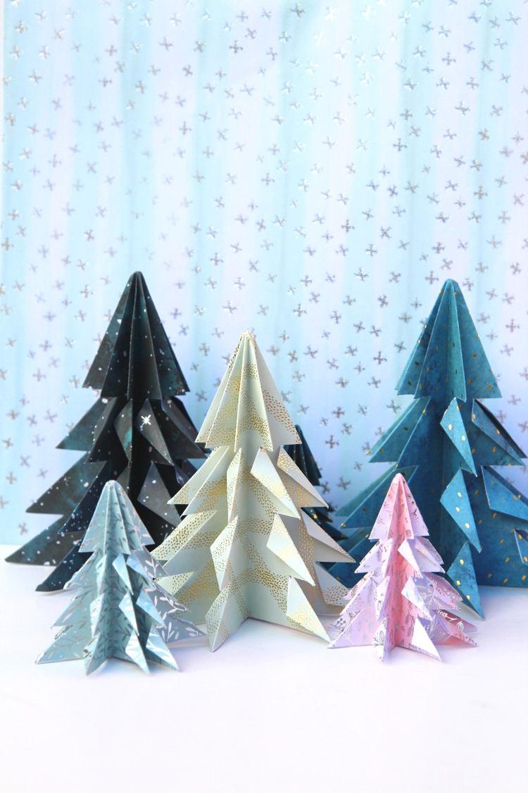 LEARN HOW TO MAKE EASY DIY ORIGAMI CHRISTMAS TREES DECORATIONS. A QUICK AND EASY LAST MINUTE HOLIDAY PROJECT THAT TAKES NO TIME AT ALL #origami #origamitree #origamichristmastree #christmas #papercrafts #craft #diy #holiday #holidaycrafts #gatheringbeauty
