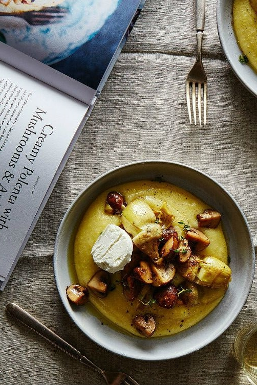 http://food52.com/recipes/33040-creamy-polenta-with-mushrooms-artichoke