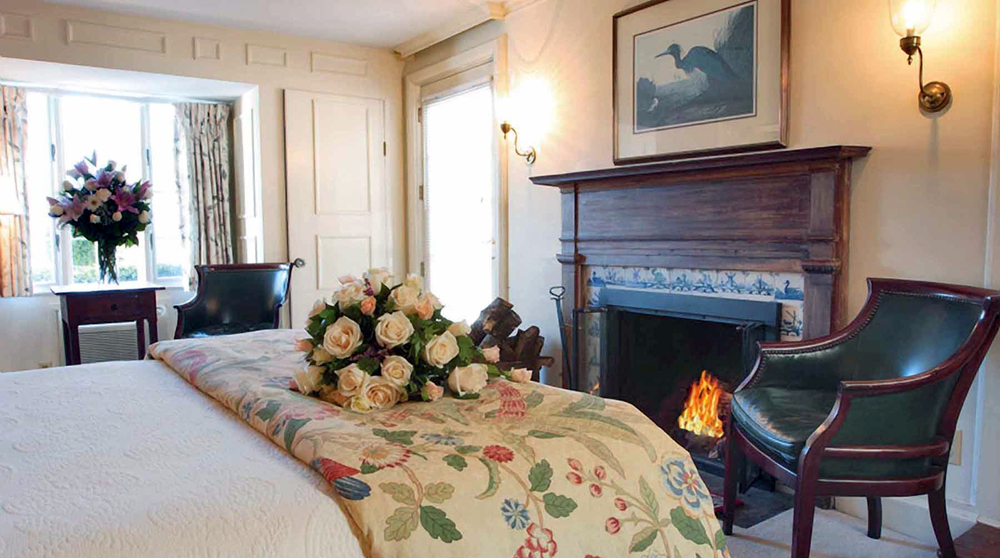 Room with fireplace, Inn at Mystic Image Property of Inn at Mystic