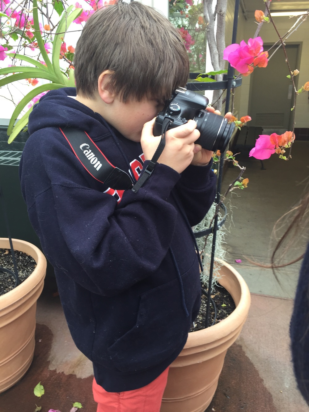My 9 year old, my camera... at the orchid show