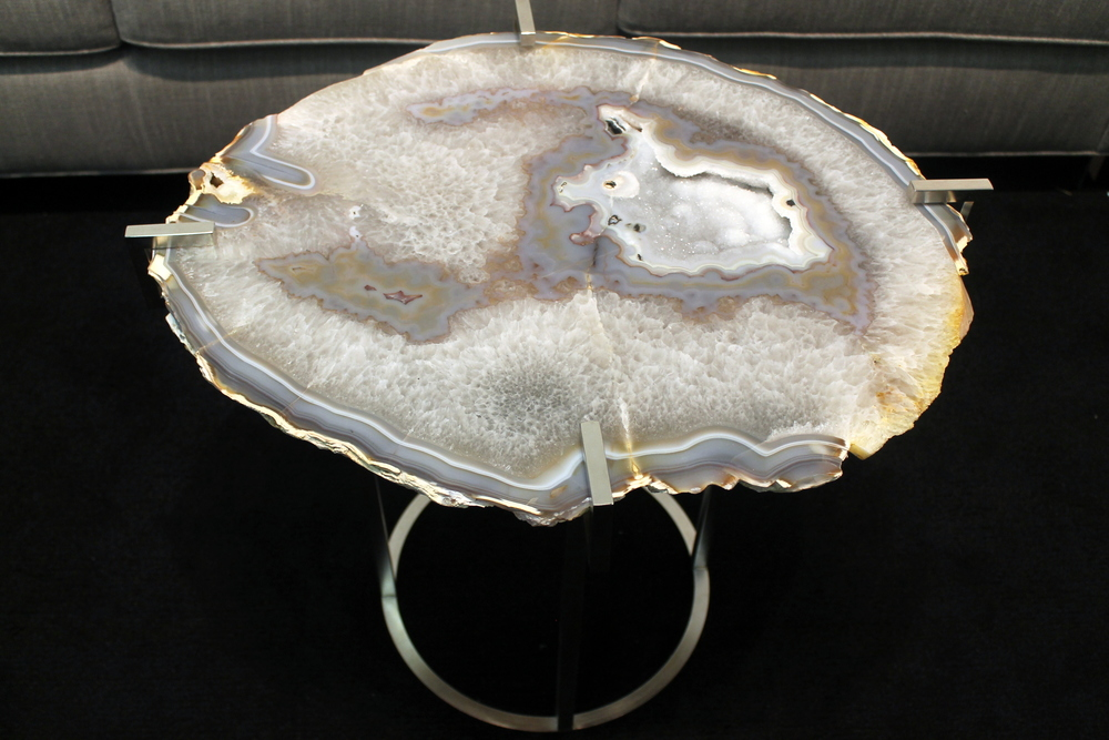 This magnificent agate table immediately caught my attention. It comes to us from The Matthew Studios collection which is inspired by nature and incorporates material that deeply resonate with founder, Katherine Wildt O'Brien, such as rough quartz crystal, semi-precious gems, exotic skins and lucite. For more information on this and other agate tables, please visit her  website  .