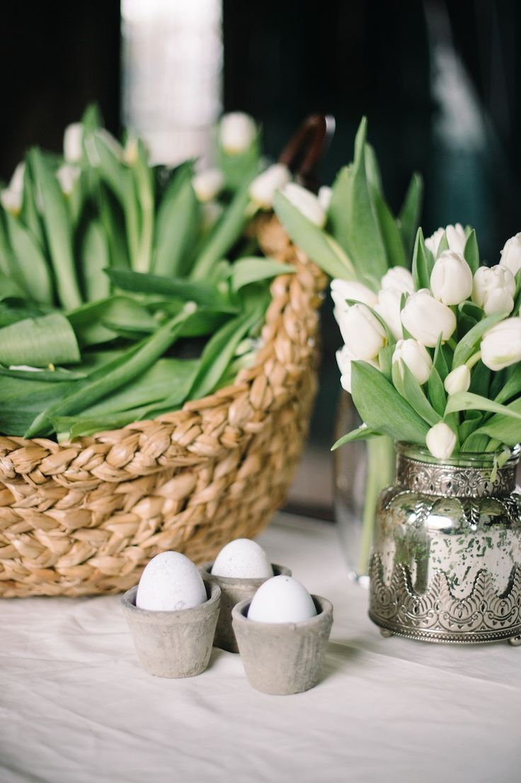 Place your tulips in a basket for a look that is a little bit unexpected and rustic. Dress it up with silver or mercury glass. White is never out of season.  Image via Pottery Barn .