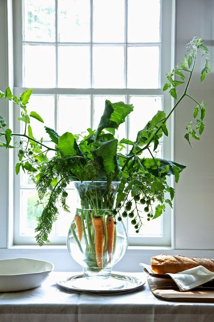I love this casual springtime creation made from greens and carrots by Karin Lidbeck-Brent. perfect for any Easter table, or buffet. Image via  Our Cozy Home .