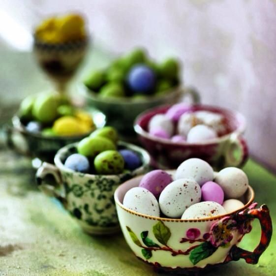 Group antique teacups together and fill them with mini chocolate eggs. You can place these on your Easter brunch or dinner table, coffee or side tables. Image via  My Luscious Life .