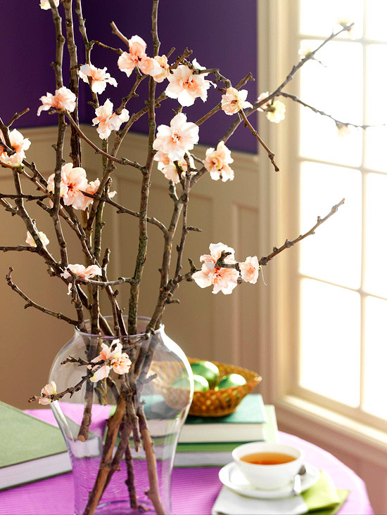 A few simple branches can be brought inside and forced open and added to your Easter table, or anywhere in your home for a touch of Spring. It takes roughly 5-7 day for flowers to appear. If you're short on time or don't have flowering bushes, simple silk flowers can be glued on to to bare branches to create an illusion of spring. Image via  Better Homes and Gardens .