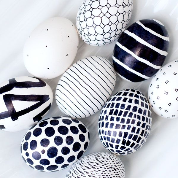 We really like the clean and simple look of the Sharpie on the egg. Slightly imperfect and simple shapes and patters drawn on to plain white eggs add a modern touch to any table. Image via  Obviously Sweet .