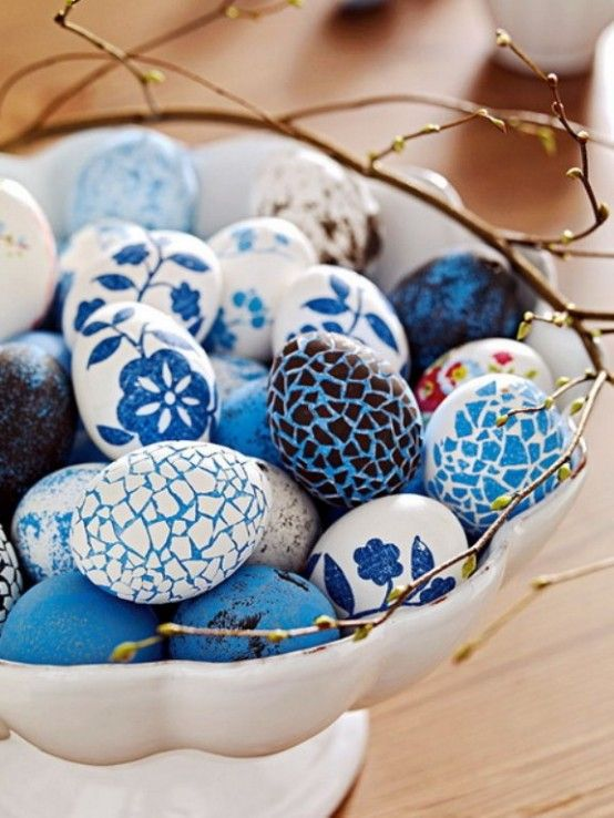 Blue and white never fades from style, especially at the Easter table. These eggs look to be done in a combination of techniques that include dyeing and decoupage. I love the mixture of patterns, colors and mediums of the eggs in the bowl as they maintain a uniform look. (I found the image on pinterest and could not locate the original source using Tineye or Google's reverse image search.)