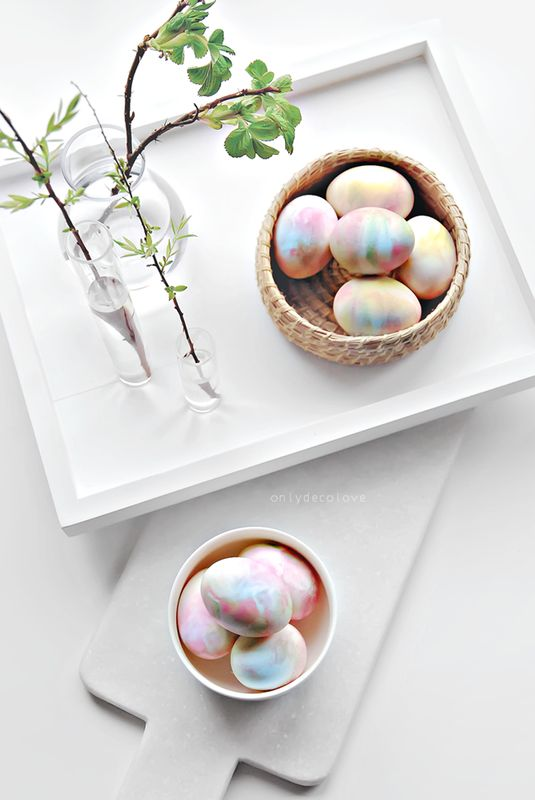 Only Deco Love  uses whipped cream to make these marbleized eggs. It looks simple enough and not so messy that little children will most likely delight in this project - and the fact that whipped cream is both sugary and edible makes this particularly sweet project. (Pun intended!) Head on over to her site for directions.