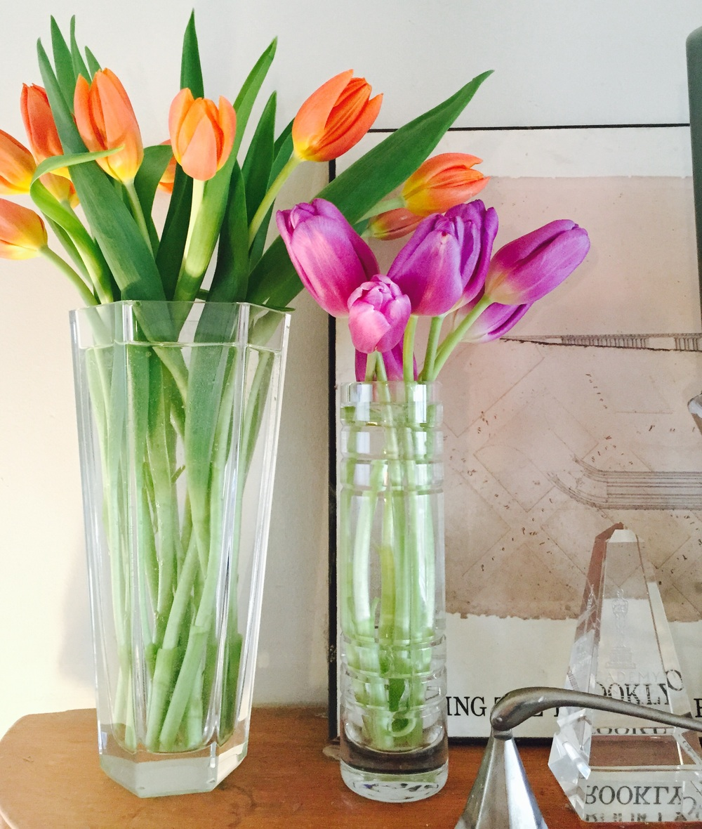 Fresh tangerine tulips and some of the remaining lavender tulips from the week before- Both vases from Tiffany & Co., Elsa Peretti Candle Snuff for Tiffany & Co. I switch vases all the time. I love to use glass pitchers for my flowers as well.