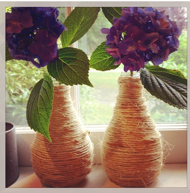 My children love Orangina bottles. I love their pear-like shape. Wrapped in twine they have a charming, country, seaside, rustic feel to them - perfect on the windowsill in my kitchen. Image, Jessica Gordon Ryan - iPhone4s