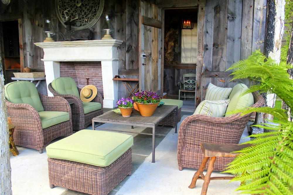 Wicker Furniture sits elegantly and casually on the porch of Bunny Williams' pool house. Image via Jessica Gordon Ryan.